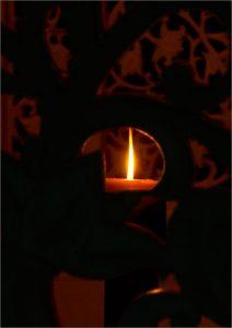 Lighted candle in Smriti Mandir.