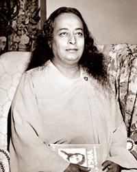 Paramahansa Yogananda holding Autobiography of a yogi