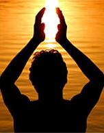 Silhouette of man praying.