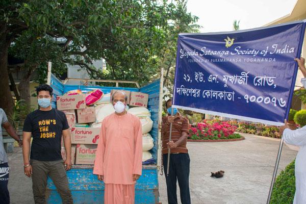 Swami Achyutananda with relief packets in Dakshineswar
