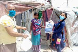 Distribution of foods in slums around Noida Ashram