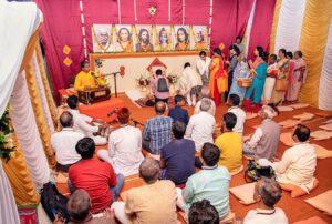 Devotees come forward for Pushpanjali.