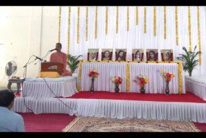 Swami Sadananda leads a day's programme at Porbandar where...