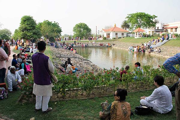 Devotees around the pond in Dihika ashram.